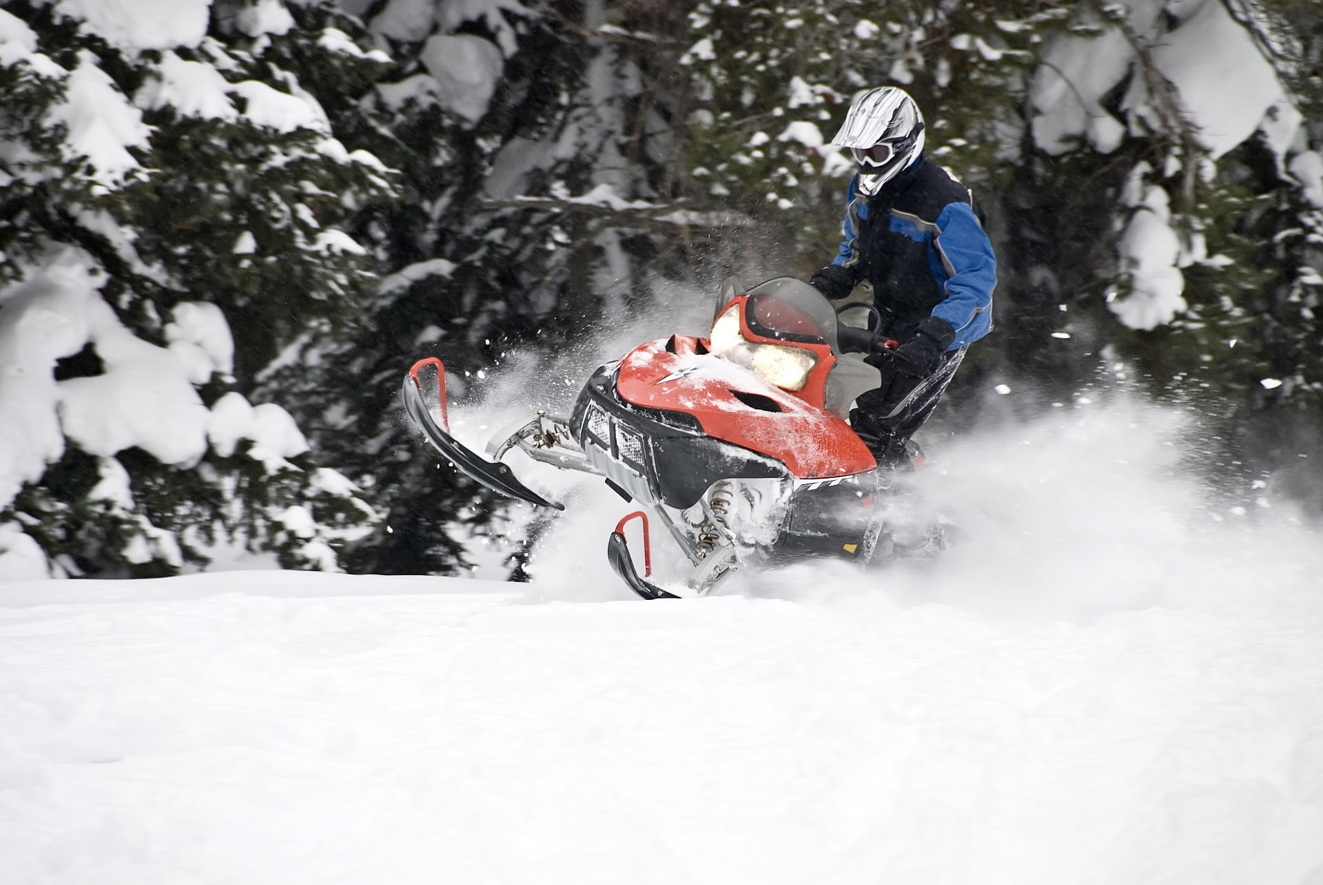 A skilled snowmobiler riding in extreme powder.  (see more snowmobilers in my portfolio.)