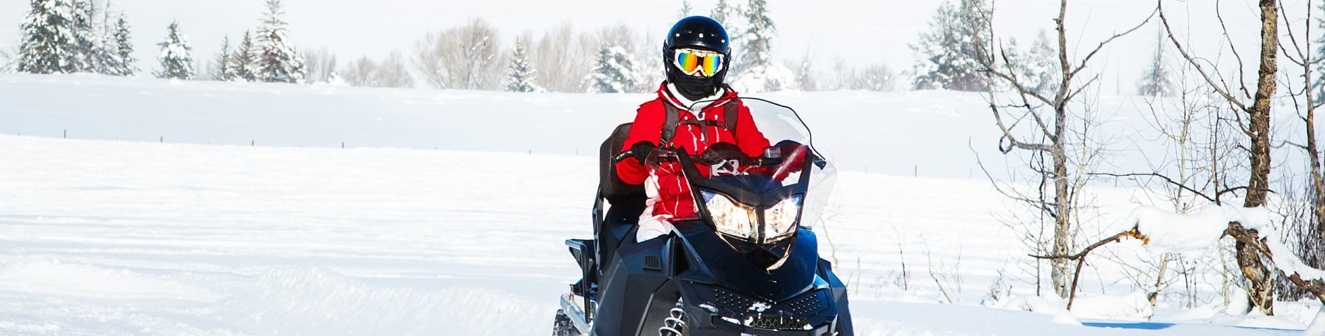 Woman driving a snowmobile in Colorado, USA - panning motion blur